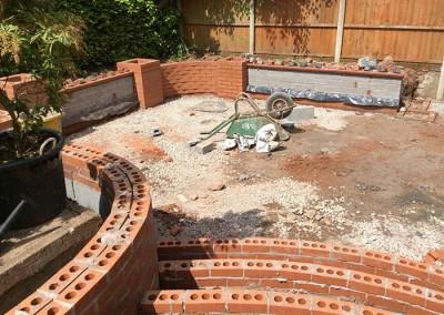 Brickwork begins on the upper tier and steps.