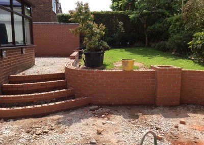 Brickwork completed on the upper tier and steps.