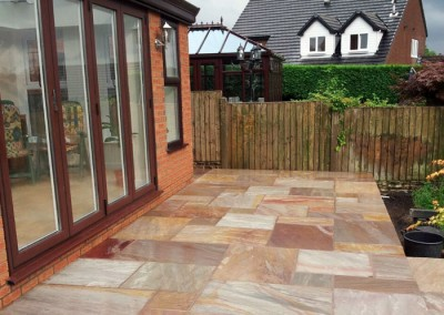 The raised patio now provides easy access to the new conservatory.
