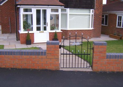 Completed boundary wall, path, gate and garden.