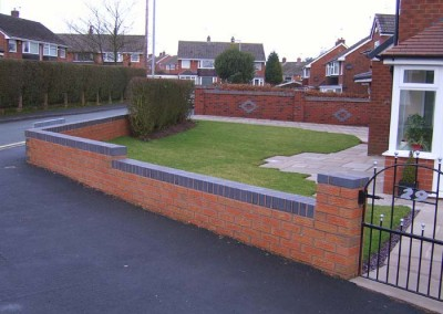 Completed boundary wall and garden.