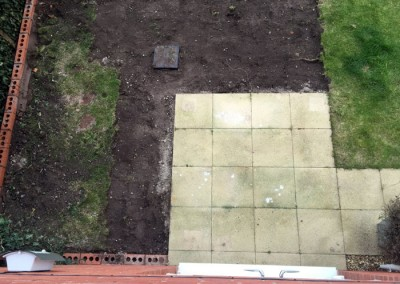 Excavation and extension of patio begins.