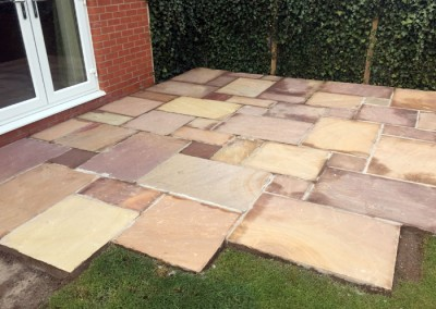 Indian stone helps the upper patio take shape.