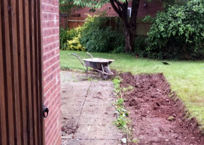 Excavation of existing garden entrance and patio.