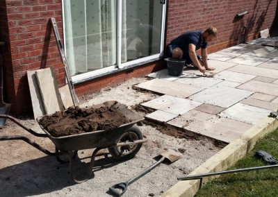 Paving underway on the garden patio.