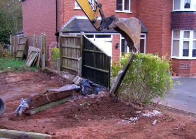 Excavation of old driveway and fences.