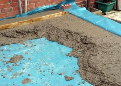 New concrete floor is laid.