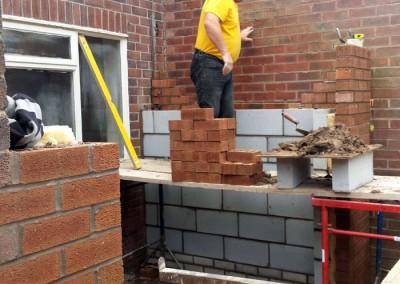 Footings are complete and brickwork begins.