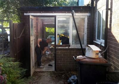 Demolition begins on existing garage.